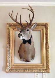 frame the deer head with gold frame and bow tie deer decor
