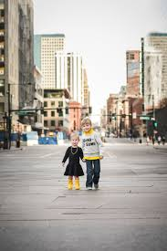 yellow boots s yellow boots in the city denver family photographer caitie