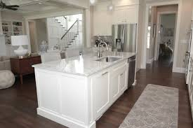 how to install cabinets with uneven ceiling how to fill space between cabinets and ceiling caroline on