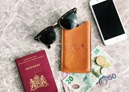 travel items images Flatlay travel items passport phone money and sunglasses stock