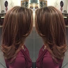 caramel highlights on light brown hair and mid length hair cut by