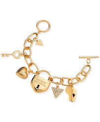 gold bracelet pendant images Lyst guess gold tone charm bracelet in metallic jpeg