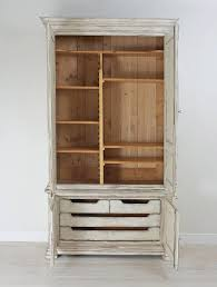 painted swedish armoire with raised panels and fluted pilasters