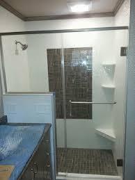glass shower doors enhance diamond pattern tile work glass