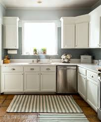 white kitchen cabinets refinishing how to paint builder grade cabinets