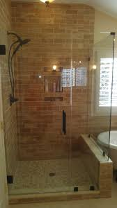 frameless shower door with earth tones and oil rubbed bronze