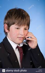 11 year school boy on mobile phone stock photo royalty free