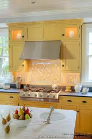 Backsplash For Yellow Kitchen Traditional Yellow Kitchen With A Custom Wood Island