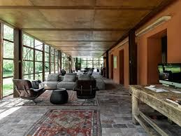 rural italian home clad in lush greenery blends into its idyllic