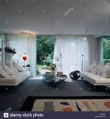 White Sofas In Living Rooms White Sofas In Nineties Living Room With White Voile Curtains On