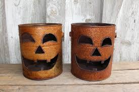rusty metal can pumpkin jack o lantern lightgiftfallrustic zoom