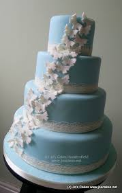 cake place 4 tier blue butterflies and lace wedding cake