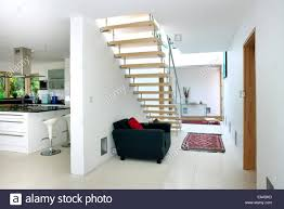 open plan staircase and hallway with view of kitchen in