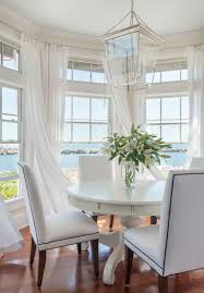 beach house chic with sunbrella sheers and upholstered chair