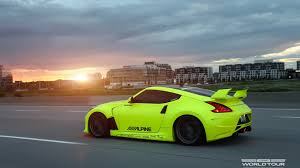 nissan yellow yellow nissan 370z on the road wallpapers and images wallpapers