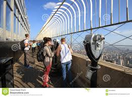 tourists on the empire state building observation deck in manhat