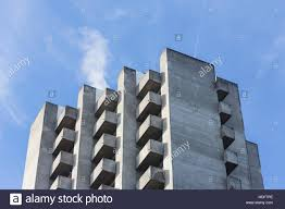 brutalism concrete highrise apartments with balcony on a slope