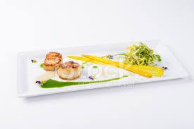 entree en cuisine gourmet scallop entree at dining restaurant stock photos