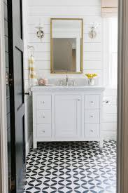 bathroom design black white mosaic tile brass hardware patterned flooring bathroom design black white mosaic tile