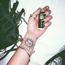 right wrist sun and moon