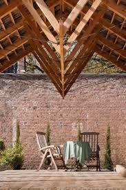 debossa installs timber pavilion in grounds of dutch mansion