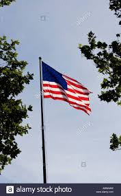 Us Flag Pole American Flag Flying In The Wind On Flag Pole On Ellis Island