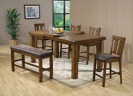 dining room oak dining table with pendant lamp and brown wooden