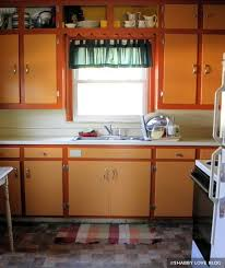 orange kitchen cabinets painting kitchen cabinets before after