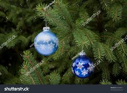 two blue christmas ornaments hanging on stock photo 63994891