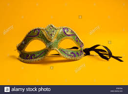 green mardi gras mask green gold purple mardi gras mask on a bright yellow background