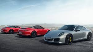 porsche dealership inside the new 911 gts is here is it the porsche you want the drive