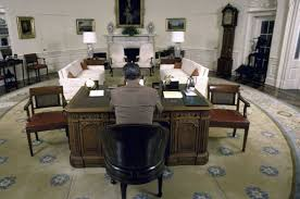 Resolute Desk President Ronald Reagan Sitting At The Resolute Desk In The Oval