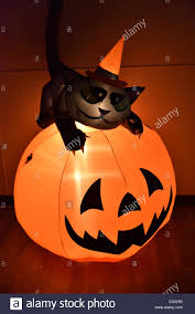 an inflatable halloween pumpkin with a black cat stock photo