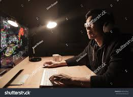 happy handsome asian male gamer playing stock photo 440915902
