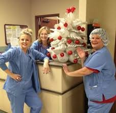 clever tree made from surgical gloves and an iv pole