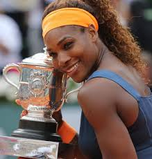 American Serena Williams holds the championship trophy after winning her French Open women's final match against Russian Maria Sharapova at Roland Garros in ... - Serena-Williams-builds-huge-lead-at-No-1-in-world-rankings