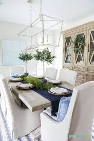 dining neutral coastal dining room with striped rug top neutral
