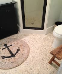 pebble stone tile with brown tile wall bathroom contemporary and