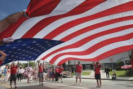 Red And White Flag With A Cross Flag Waving Californians Turn Out For July 4th Parades 710 Knus