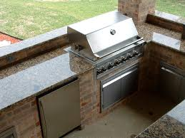 this outdoor kitchen with beautiful countertops would be a