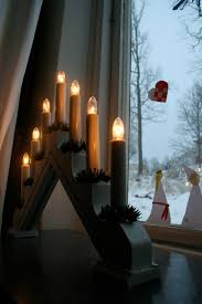 swedish christmas candles in every swedish window all during the
