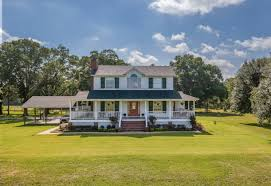 26 acres with a gorgeous custom built home with wrap