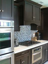 what backsplash goes with brown cabinets contemporary kitchen with rich brown cabinetry and mosaic