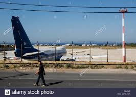 5 7 Billion by A Man Walks Outside The Old Athens U0027 Airport At Hellenikon Suburb