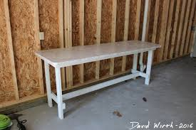 workbench from 2x4 s easy build plans then i put it back together in the garage it seems to fit well along the wall and hopefully will get a lot of use workbench