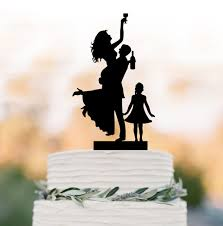 funny wedding cake topper with child drunk bride and groom