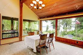 spacious dining area in log cabin house with high vaulted ceiling