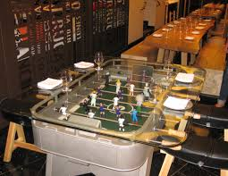 foosball table ready to welcome you to dine gayot u0027s blog