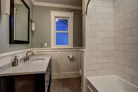 cottage full bathroom with wall sconce by board and vellum