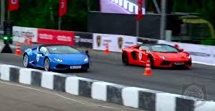 lamborghini aventador race sibling rivalry lamborghini s aventador roadster takes on
